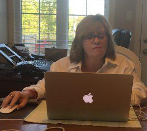 Leanne Fournier writing on laptop