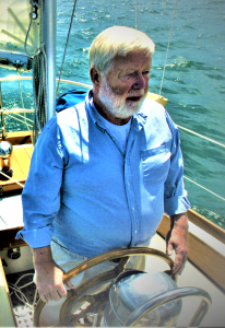 Older man sailing a boat